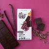 Theo Vanilla Cocoa Nib 85% Dark Chocolate Bar, unwrapped with vanilla and cocoa nibs