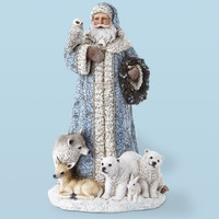Santa figurine in blue with woodland animals