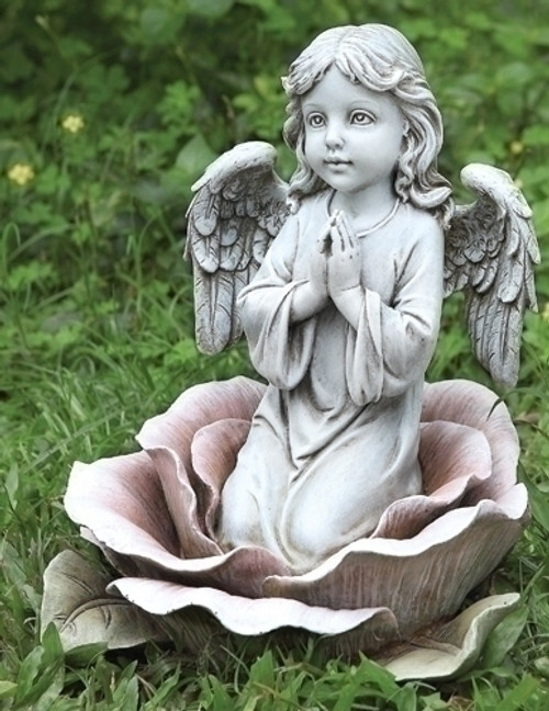 Angel  kneeling in a rose garden statue