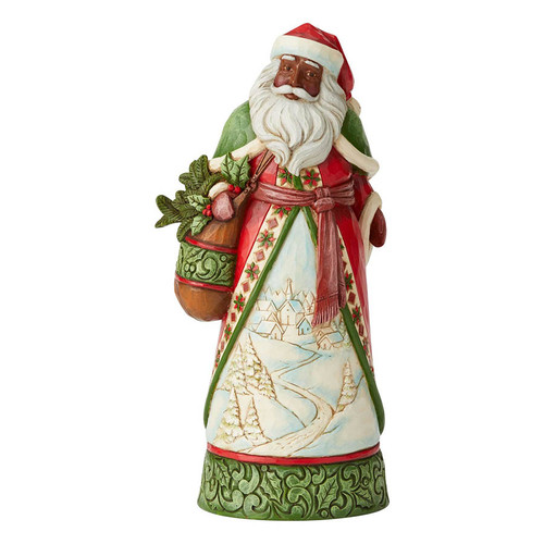 African American Santa Claus figurine by Jim Shore.  This black Santa  brings joy wherever he goes.  His cloak features a wandering , snow covered, cobblestone path