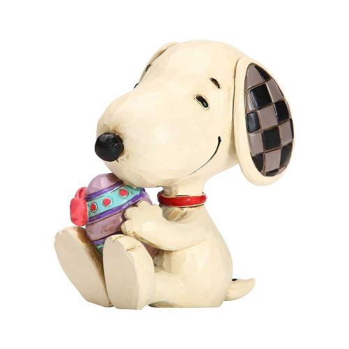 Jim Shore Peanuts Snoopy holding Easter Egg figurine