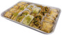 Assorted Baklava pieces beautifully arranged on a rectangular tray - Side angled view - Libanais Sweets
