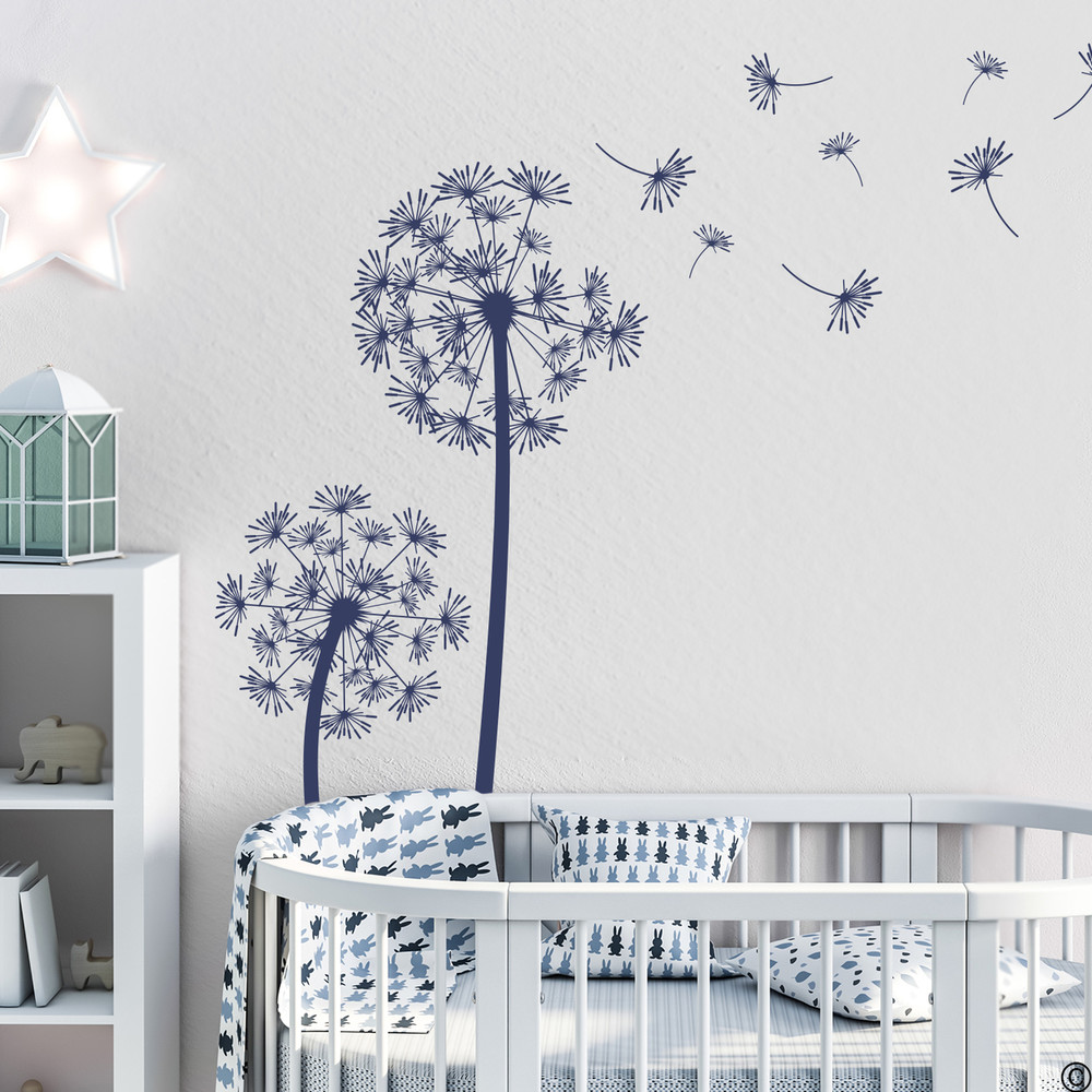 The Freya dandelion wall decal in dark blue vinyl and in a nautical themed nursery room.