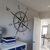 Customer photo of The Captain compass rose vinyl wall decal in dark grey