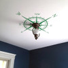 Customer photo of a ceiling installation of The Captain compass rose vinyl wall decal in green
