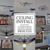 Customer photos of the ceiling installation process for the Charles compass decal.