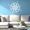 The Christopher Compass wall decal in white vinyl and placed over a couch in a living room.