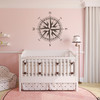 The Christopher Compass wall decal in brown vinyl and placed over a crib in a girls nursery room.