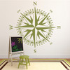 The Christopher Compass wall decal in marsh vinyl and placed beside a chalkboard in a class  room.