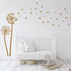 The Freya dandelion wall decal in clay brown vinyl over a crib  in a nursery room.