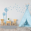The Freya dandelion wall decal in bayou blue vinyl and placed in a kids playroom.