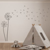 The Freya dandelion wall decal in castle grey vinyl and placed in a kids playroom.