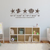 Sea Life wall decal, includes three starfish, one shell, one fish, and customizable GPS coordinates with town and state name. Shown here in brown vinyl and on a child's bedroom wall.