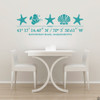 Sea Life wall decal, includes three starfish, one shell, one fish, and customizable GPS coordinates with town and state name. Shown here in teal vinyl and on a wall above a kitchen table.