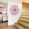 """The """"Not all who wander are lost"""" distressed compass rose wall decal shown here in limited edition plumberry vinyl."""