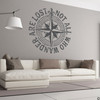 """The """"Not all who wander are lost"""" distressed compass rose wall decal shown here in dark grey vinyl."""