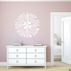 """The """"Not all who wander are lost"""" distressed compass rose wall decal shown here in white vinyl."""