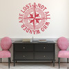 """The """"Not all who wander are lost"""" distressed compass rose wall decal shown here in dahlia red vinyl."""
