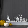 The Halloween houses wall decal in light grey vinyl color.