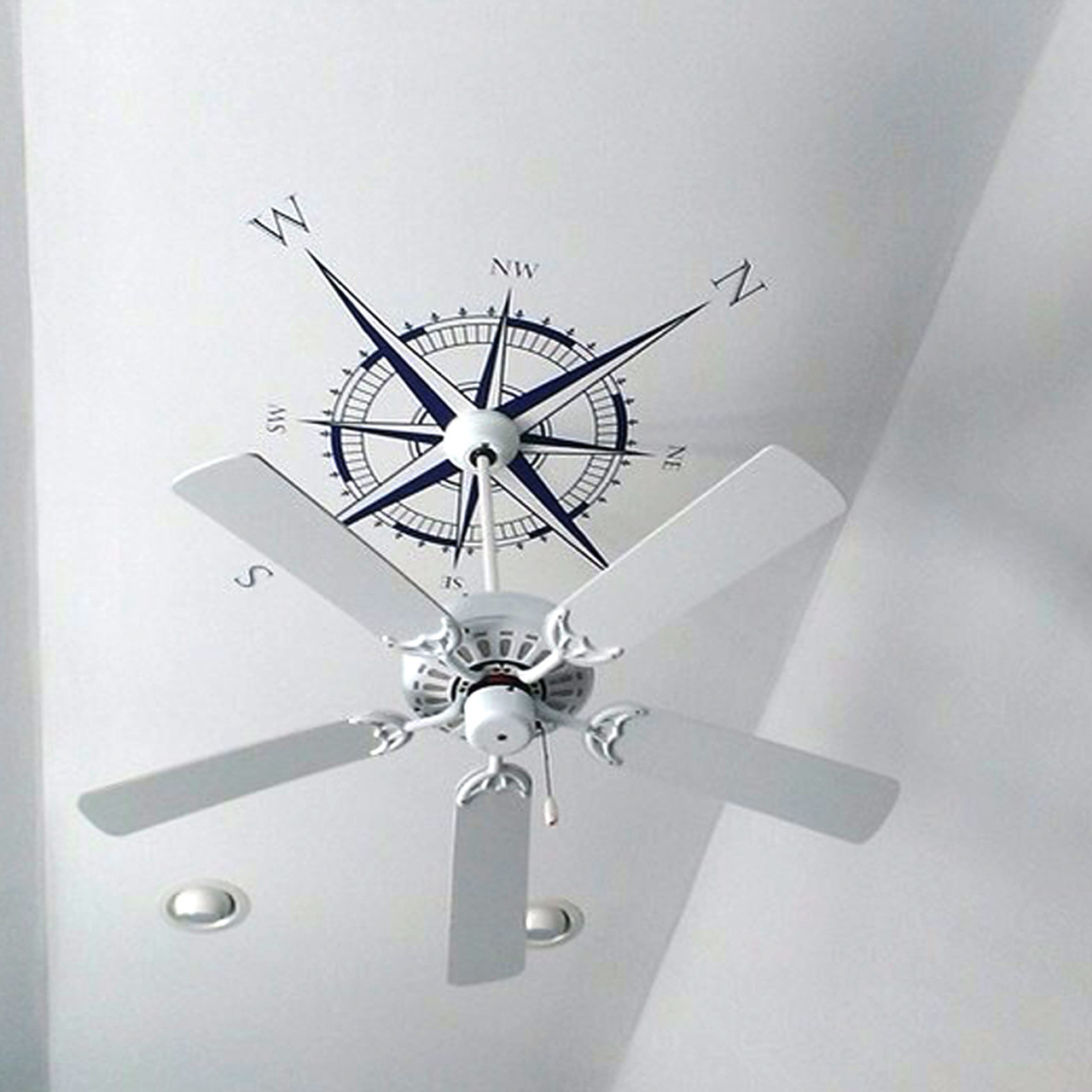 Customer photo of The Explorer Compass wall or ceiling decal shown here in dark blue vinyl.