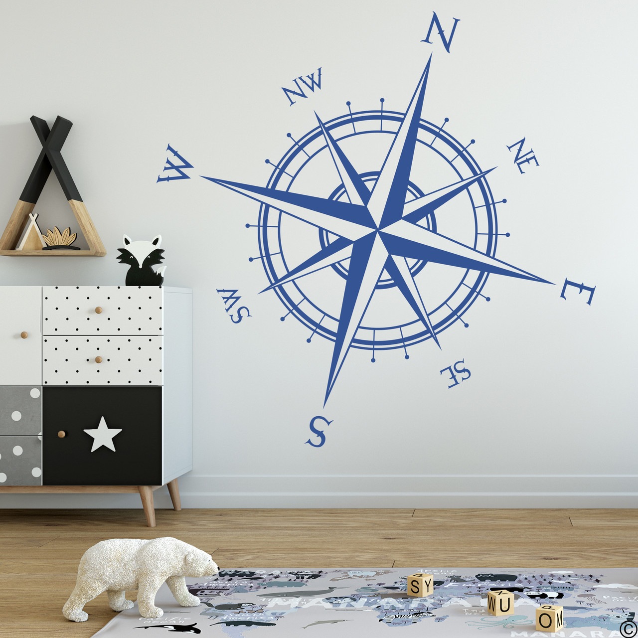 The Captain compass rose wall decal shown here in limited edition denim vinyl color.
