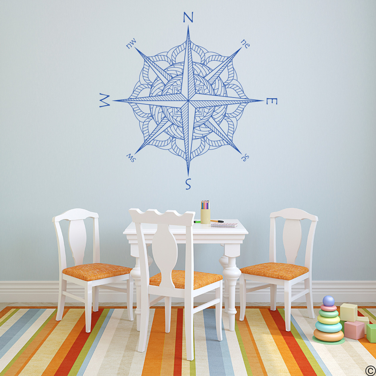 The Catalina compass rose wall or ceiling decal in traffic blue