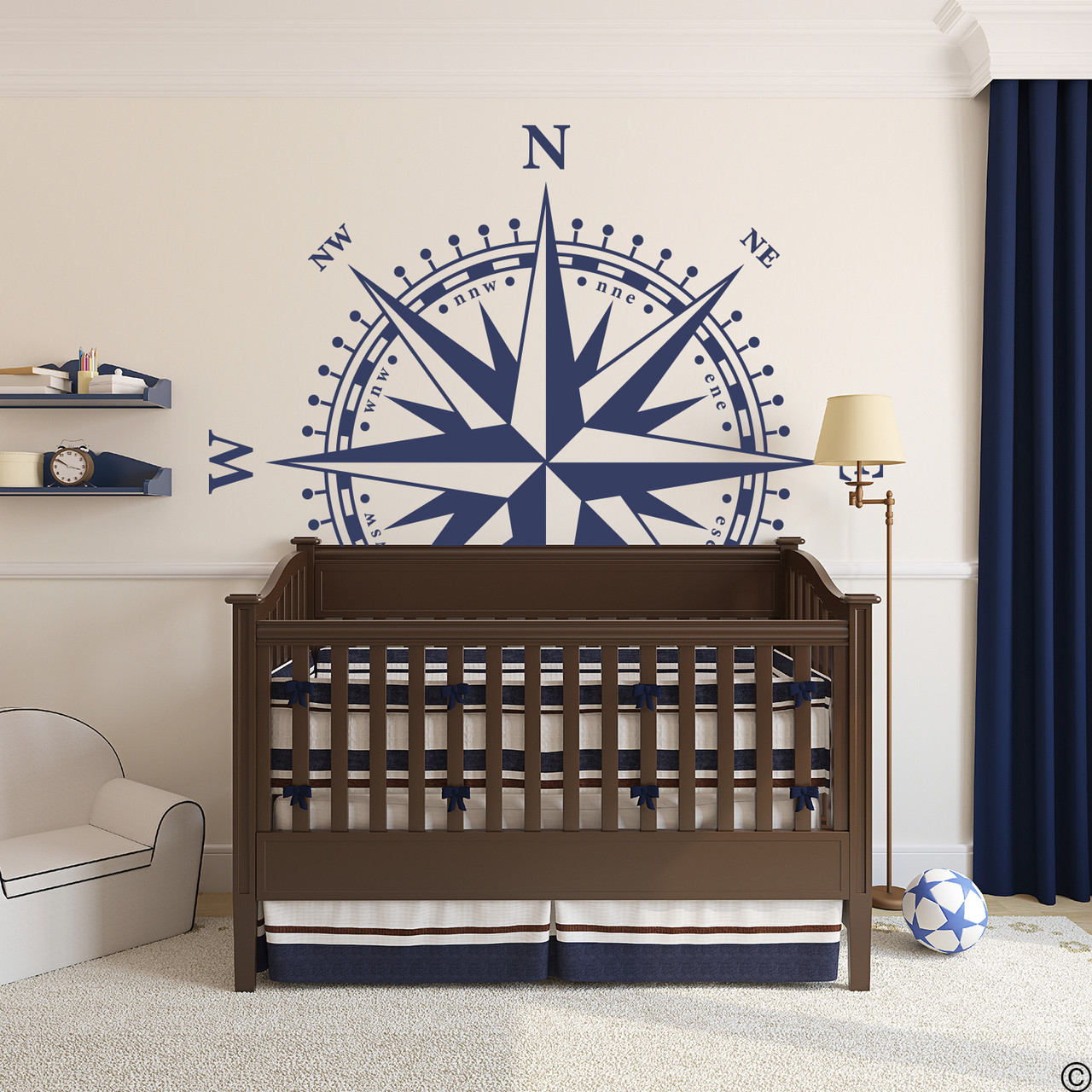 The Christopher Compass wall decal in dark blue vinyl and placed over a crib in a boys nursery room.