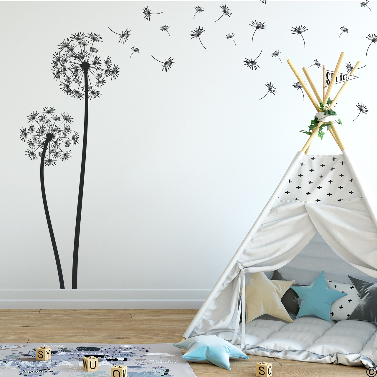 The Freya dandelion wall decal in black vinyl and placed in a kids playroom.