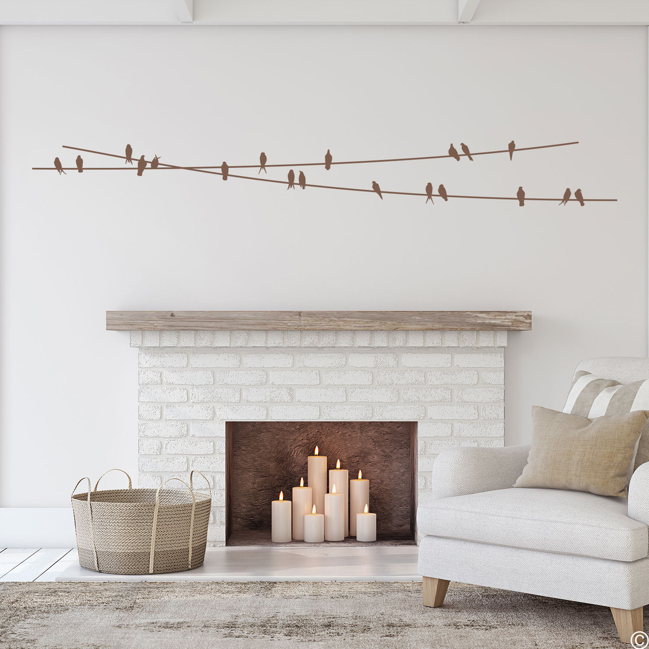 """The """"Birds On Wire"""" wall decal placed above a fireplace in clay brown vinyl color."""