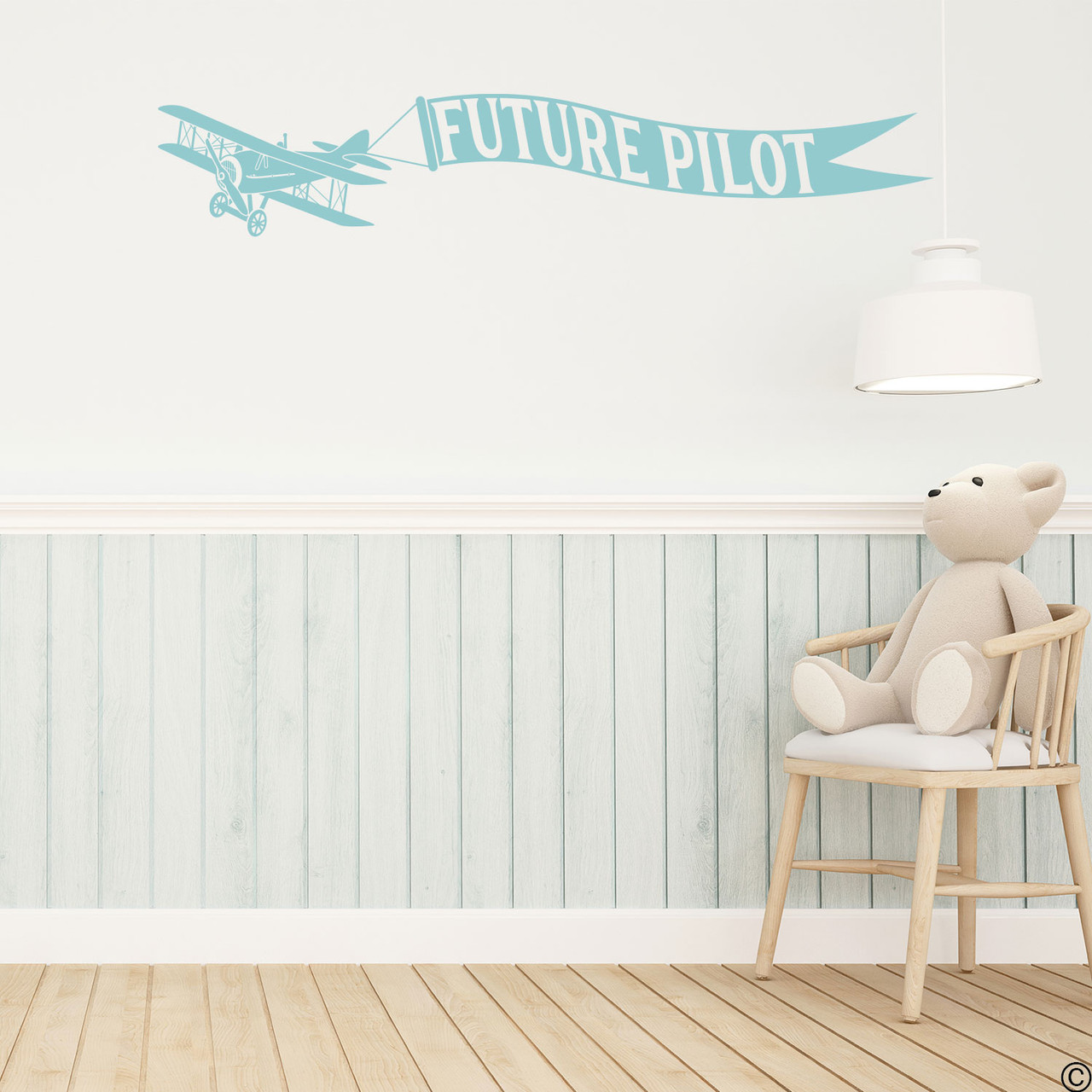 Biplane wall decal with customizable name banner on a kids playroom wall in limited edition beach house vinyl.