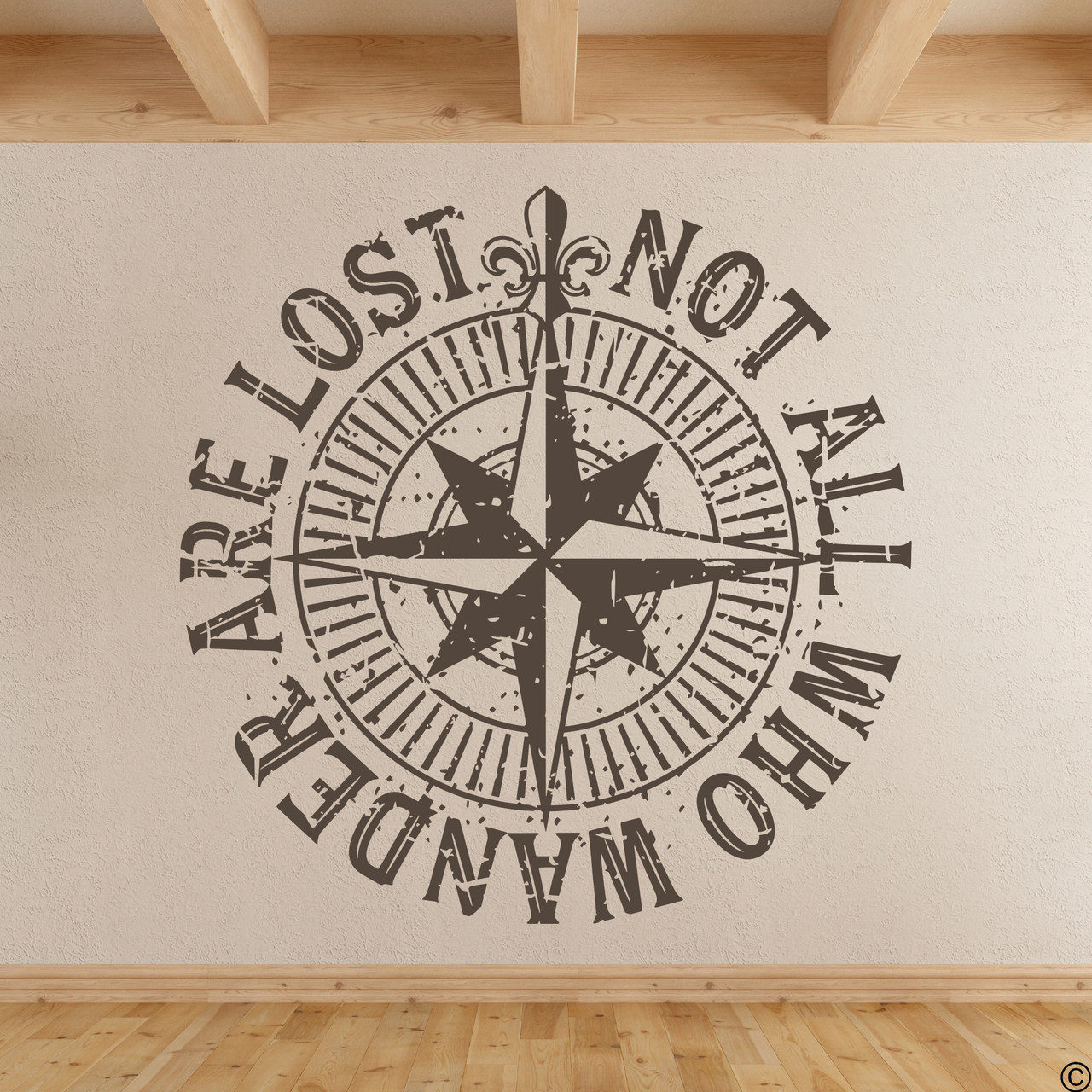 """The """"Not all who wander are lost"""" distressed compass rose wall decal shown here in brown vinyl."""