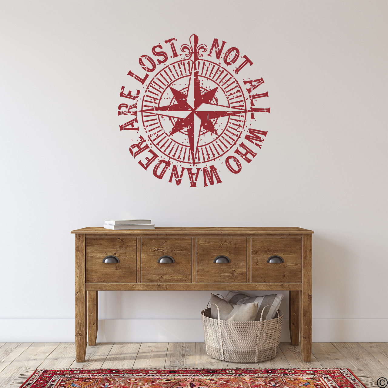 """The """"Not all who wander are lost"""" distressed compass rose wall decal shown here in dark red vinyl."""