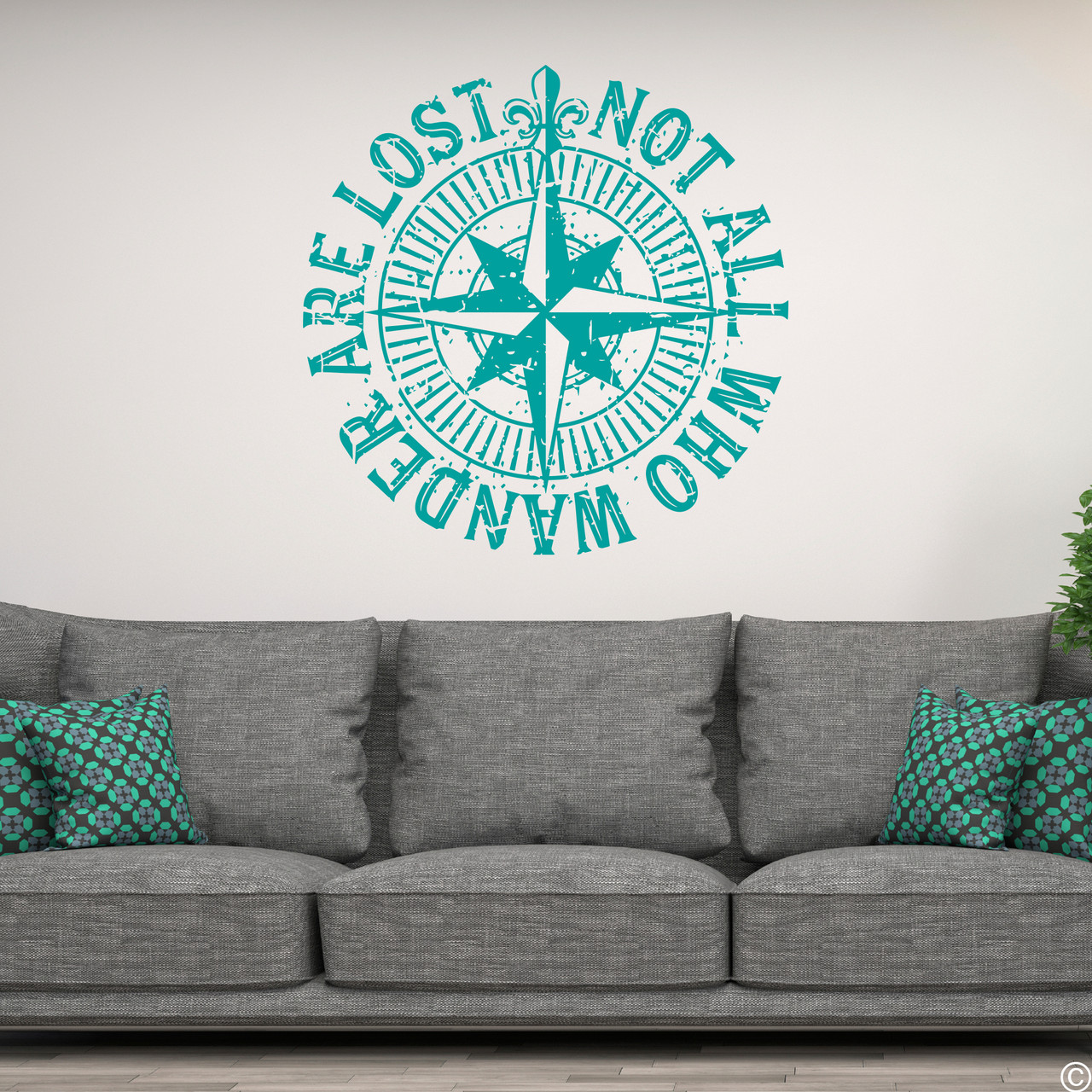 """The """"Not all who wander are lost"""" distressed compass rose wall decal shown here in turquoise vinyl."""