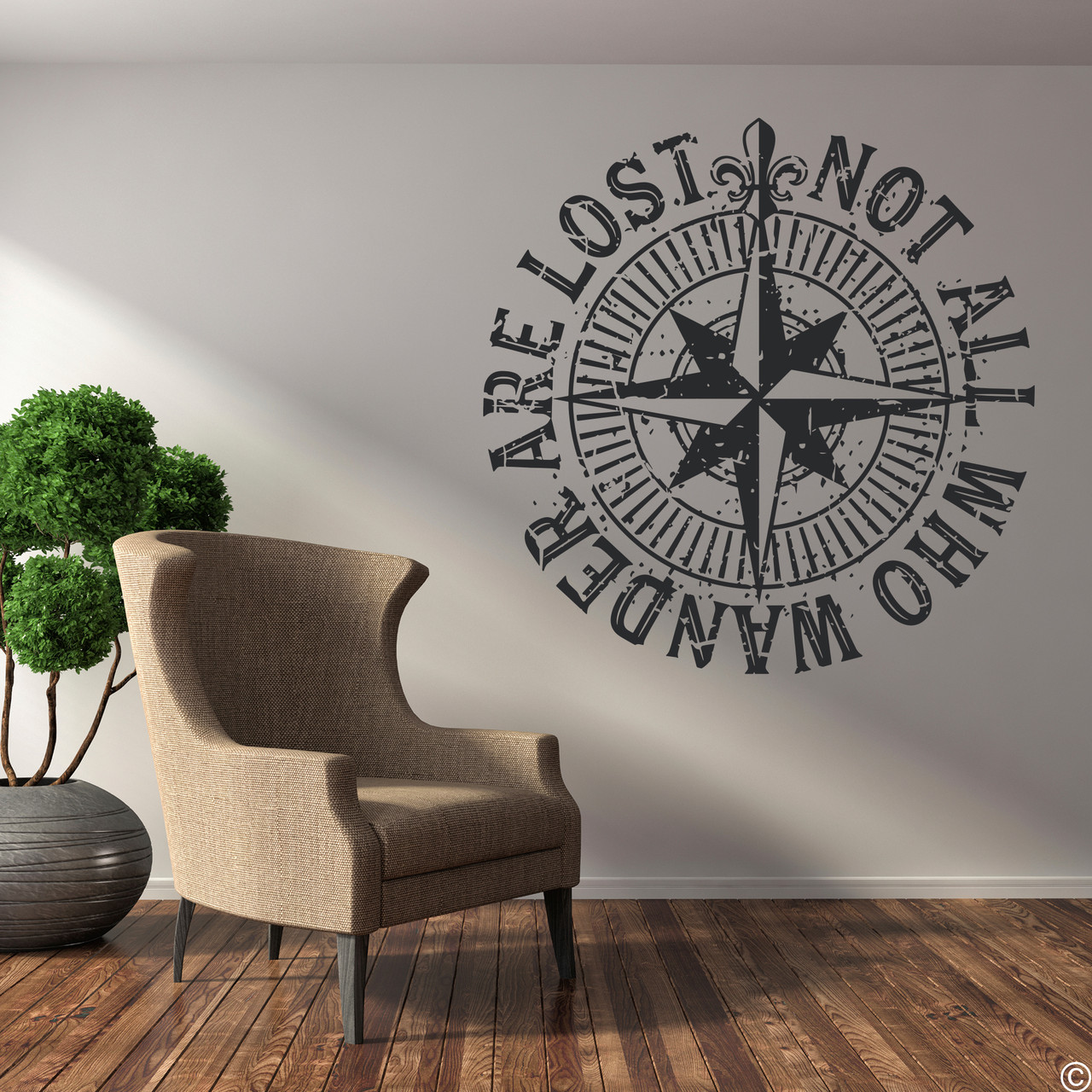 """The """"Not all who wander are lost"""" distressed compass rose wall decal shown here in black vinyl."""