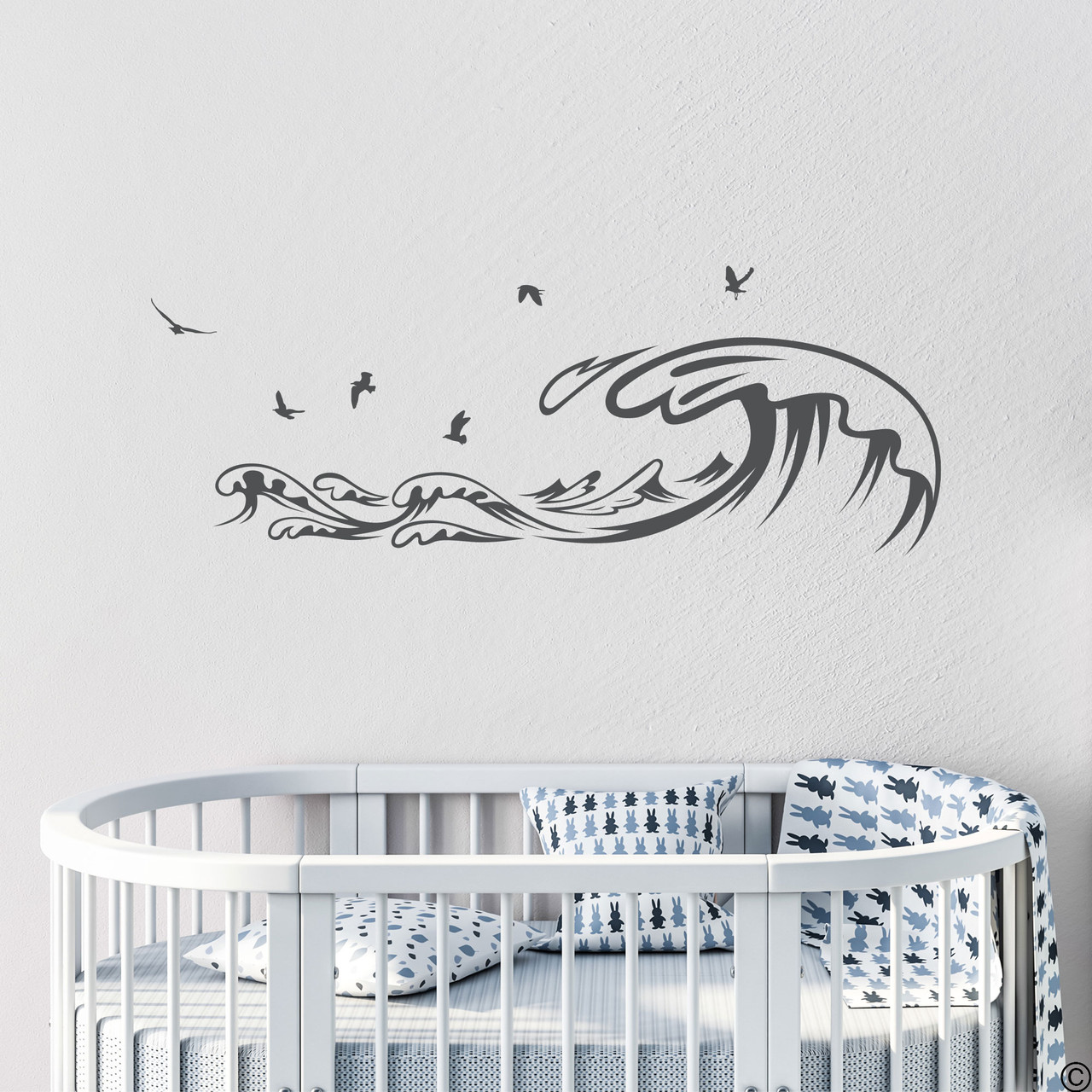 The Waves and Seagulls wall decal shown here in the dark grey vinyl color.