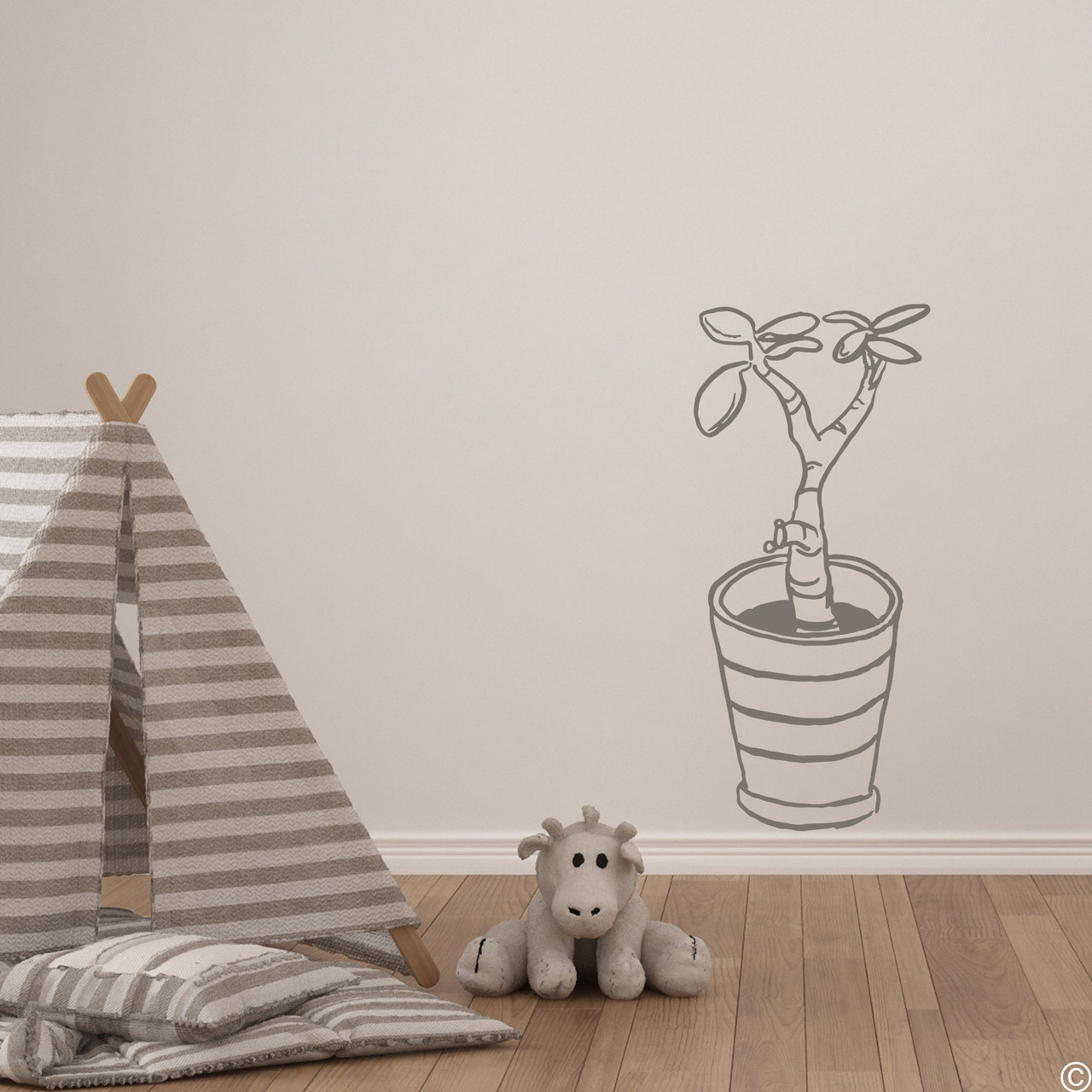The hand drawn baby jade potted plant wall decal in the limited edition castle grey vinyl color.