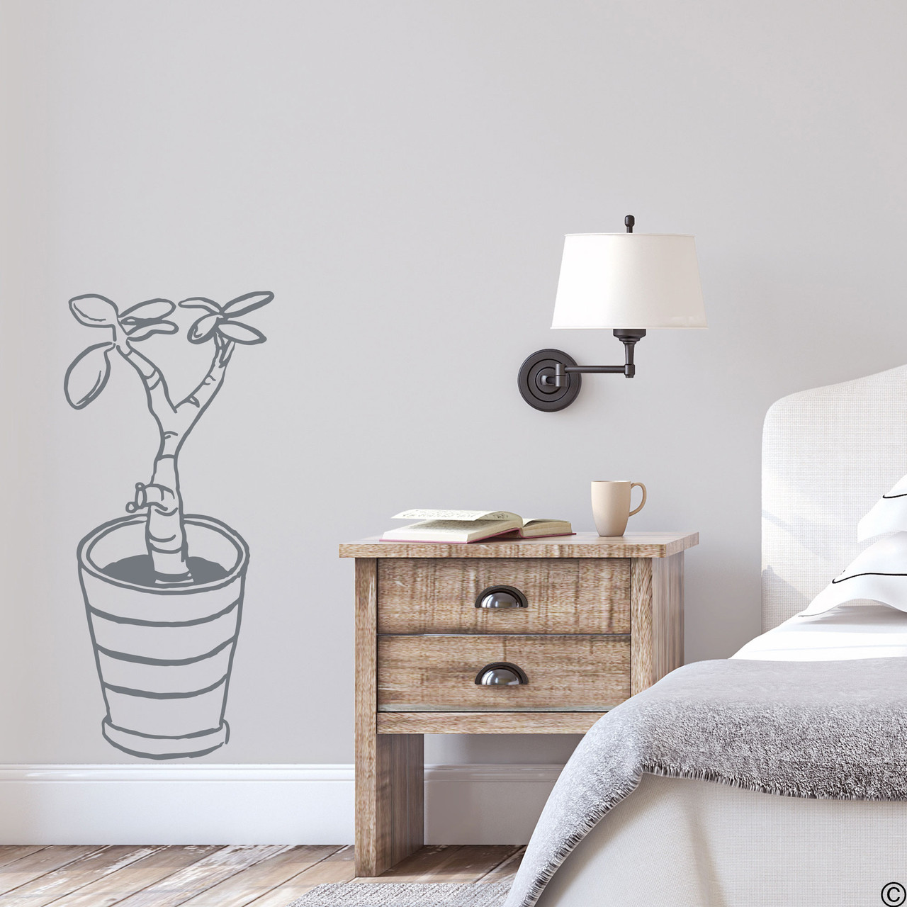 The hand drawn baby jade potted plant wall decal in the storm grey vinyl color.