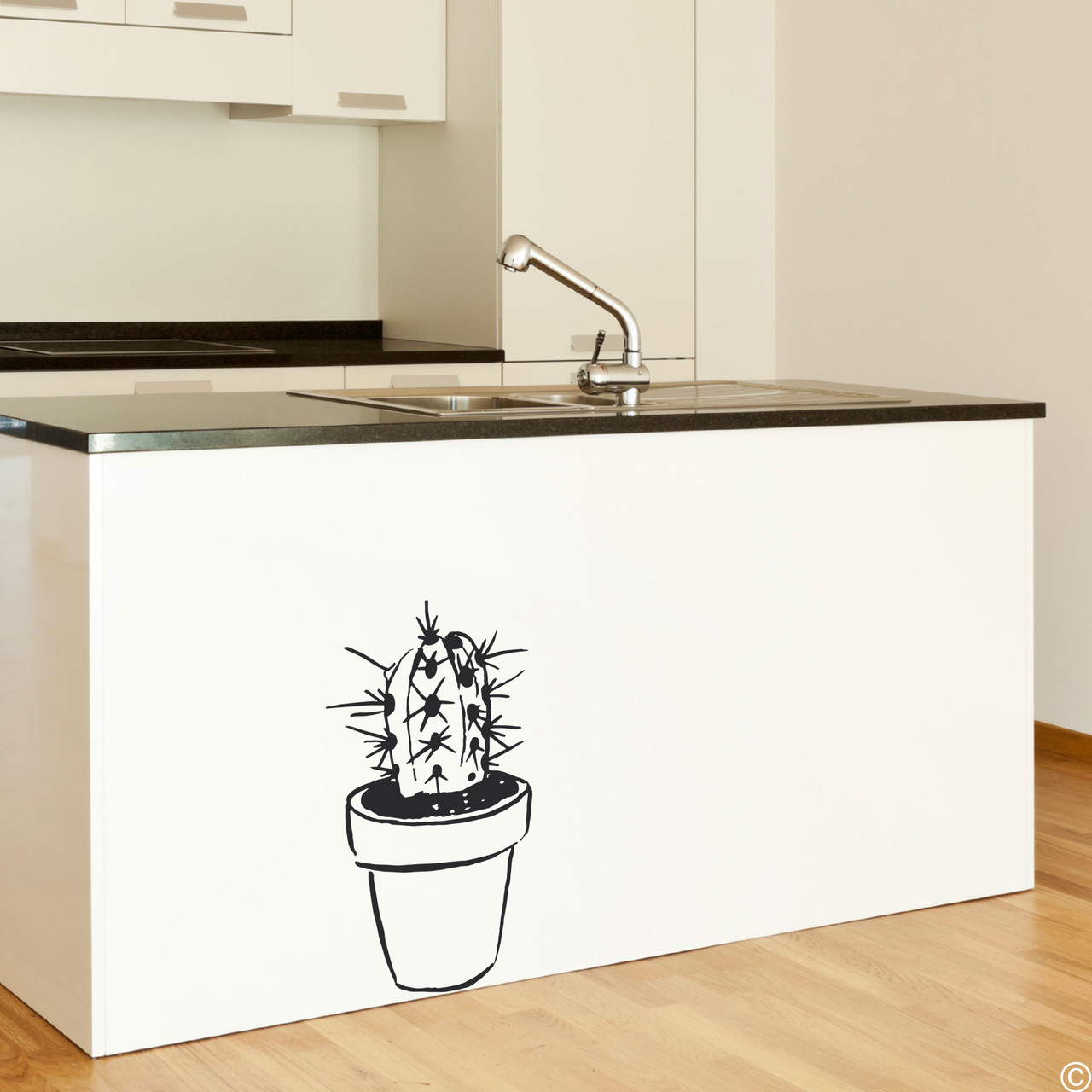 The hand drawn potted cactus wall decal in black vinyl color.