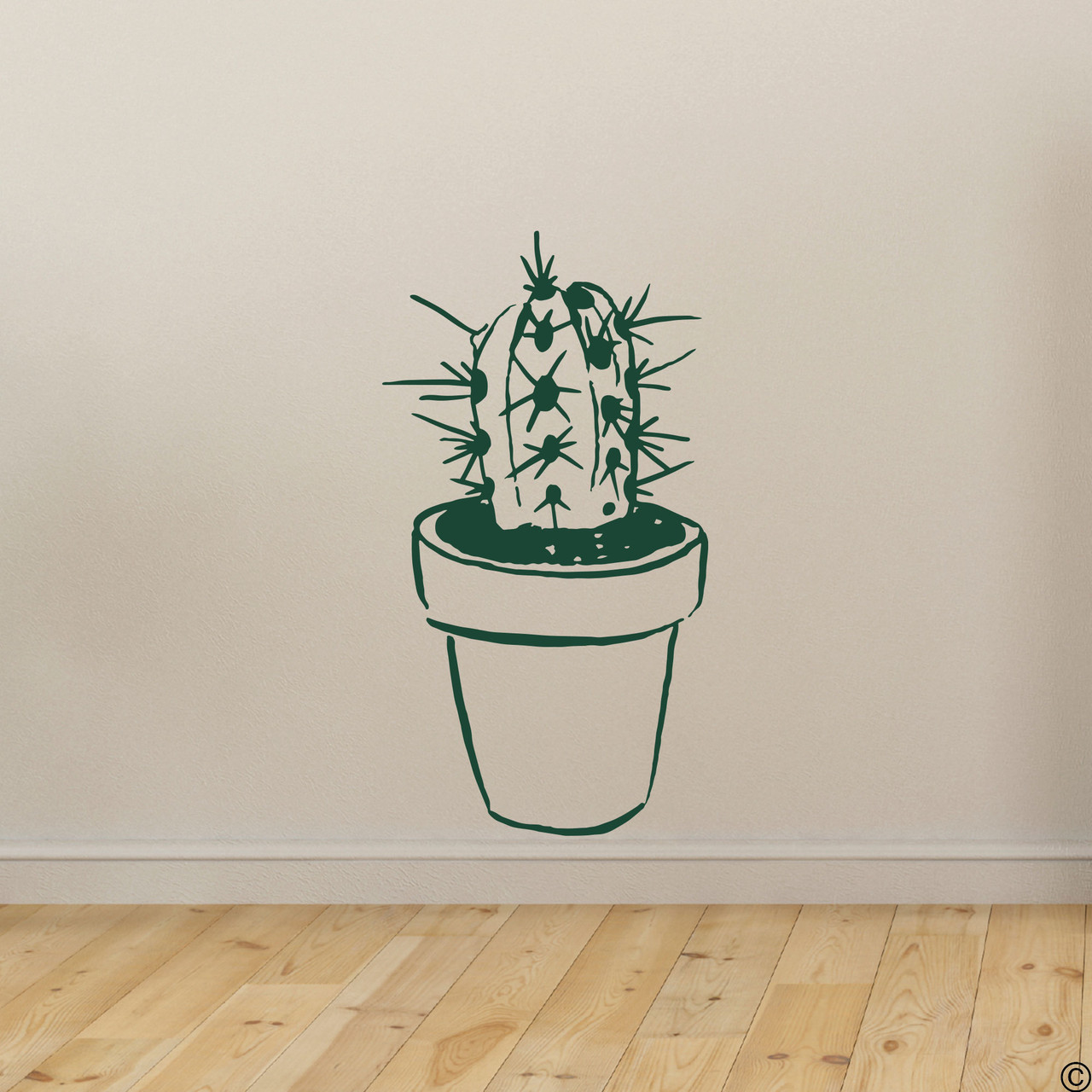 The hand drawn potted cactus wall decal in dark green vinyl color.