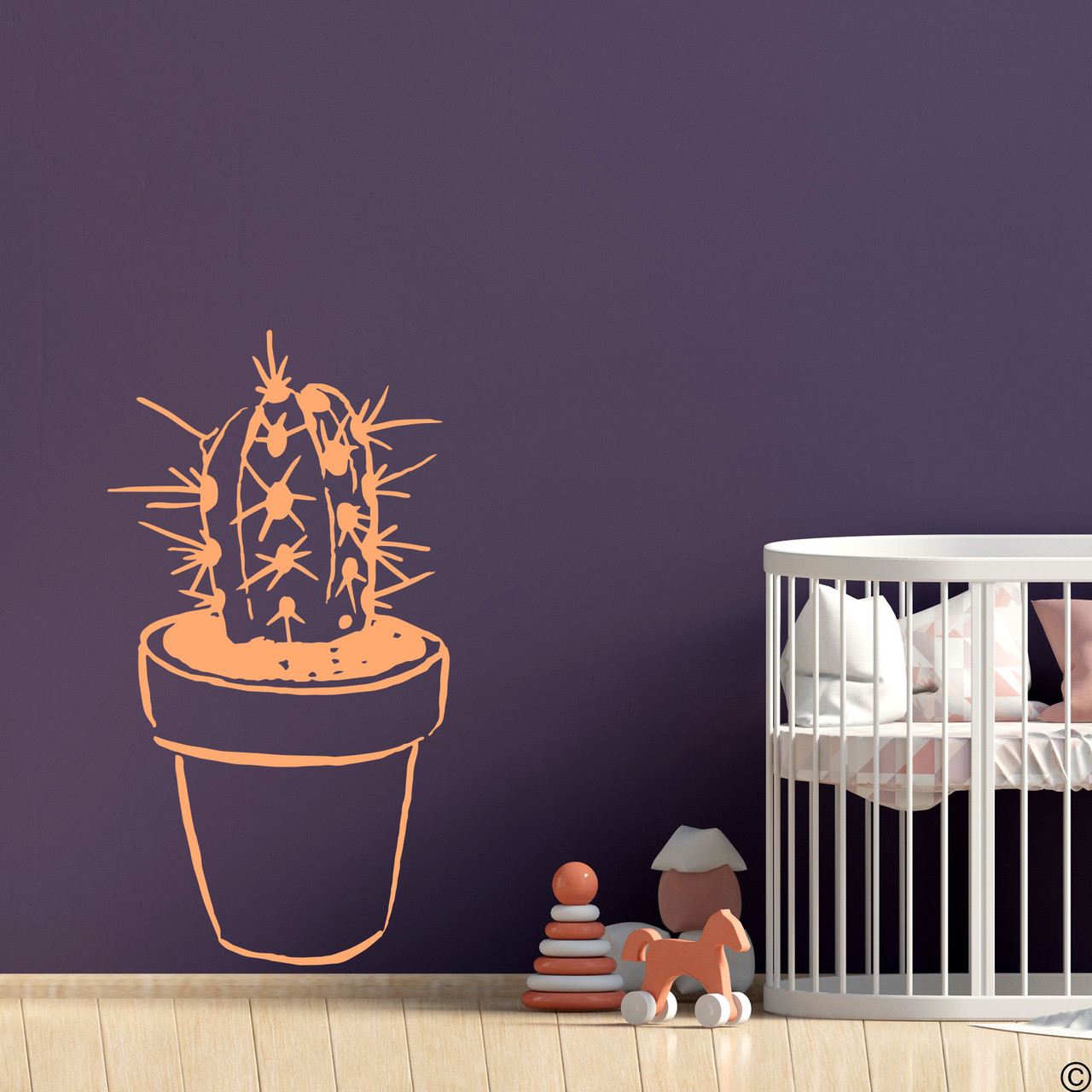The hand drawn potted cactus wall decal in limited edition apricot vinyl color.