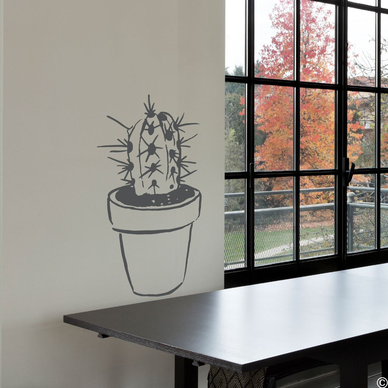 The hand drawn potted cactus wall decal in dark grey vinyl color.