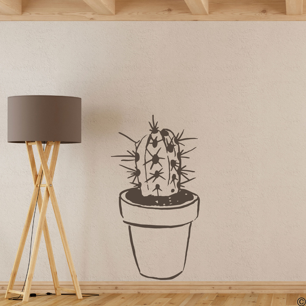 The hand drawn potted cactus wall decal in brown vinyl color.