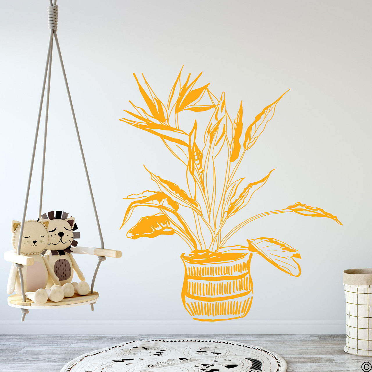 The hand drawn Bird of Paradise potted plant wall decal in the golden yellow vinyl color.