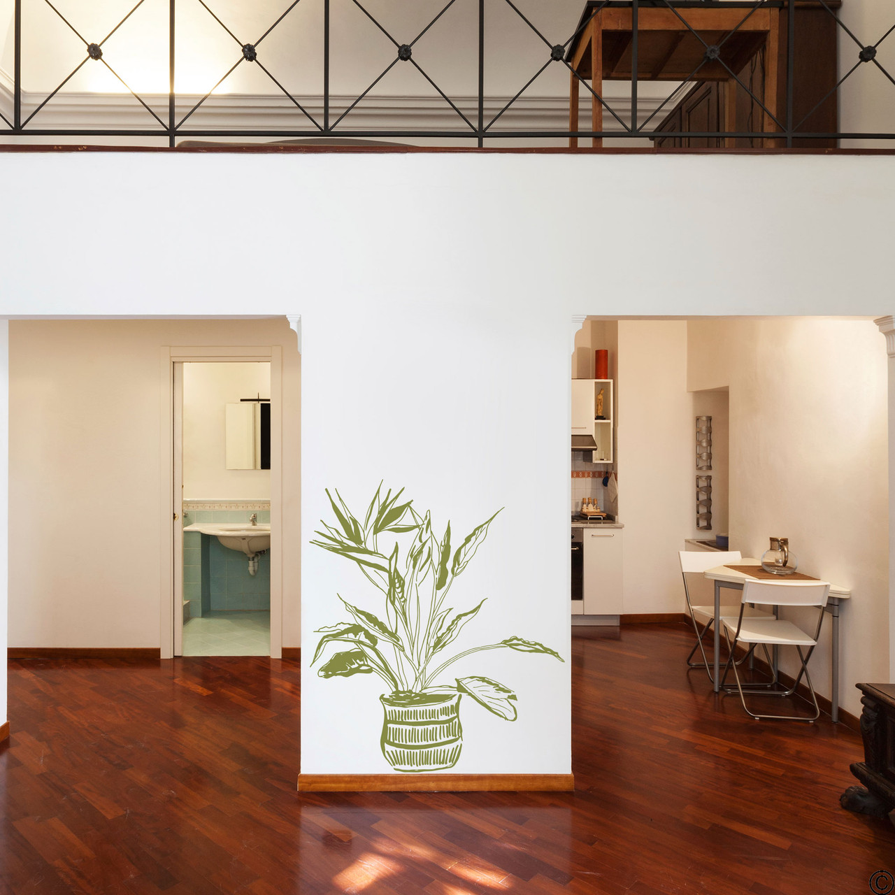 The hand drawn Bird of Paradise potted plant wall decal in the limited edition marsh green vinyl color.