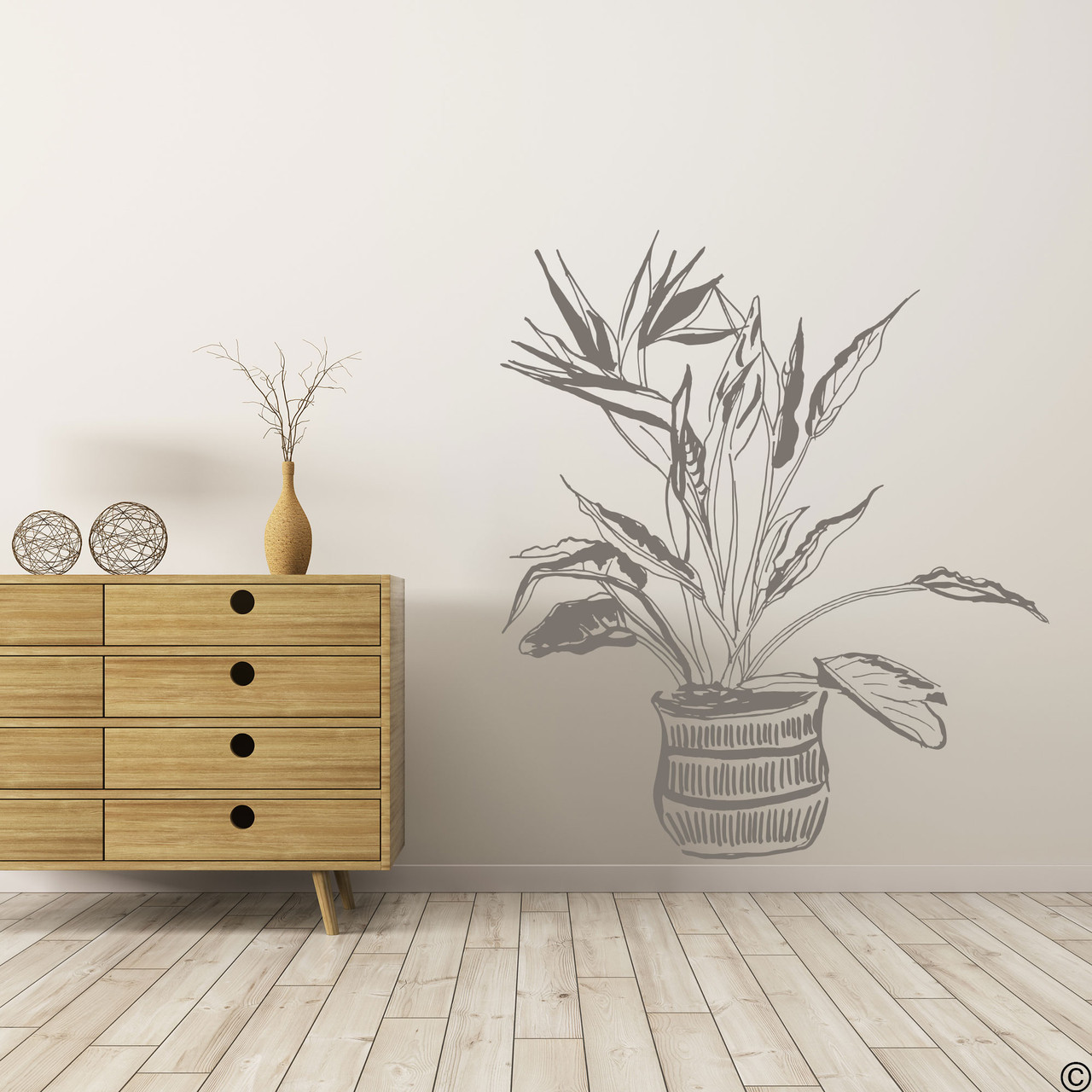 The hand drawn Bird of Paradise potted plant wall decal in the limited edition castle grey vinyl color.