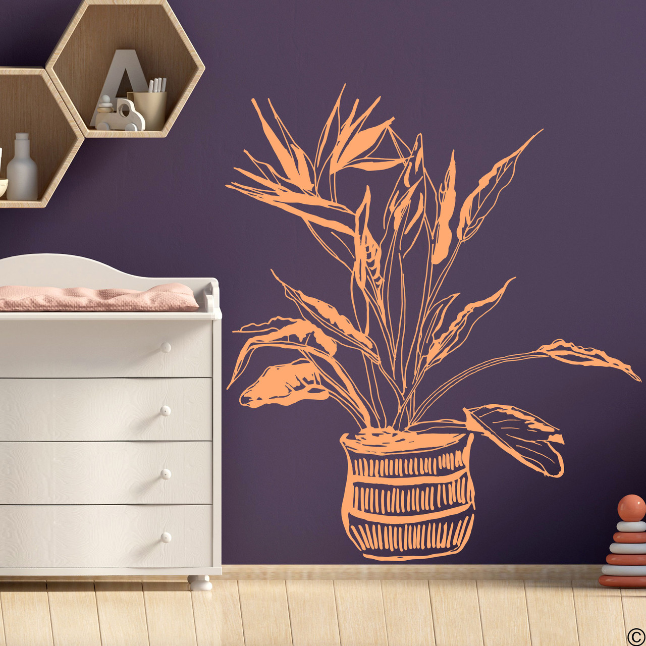 The hand drawn Bird of Paradise potted plant wall decal in the limited edition apricot vinyl color.