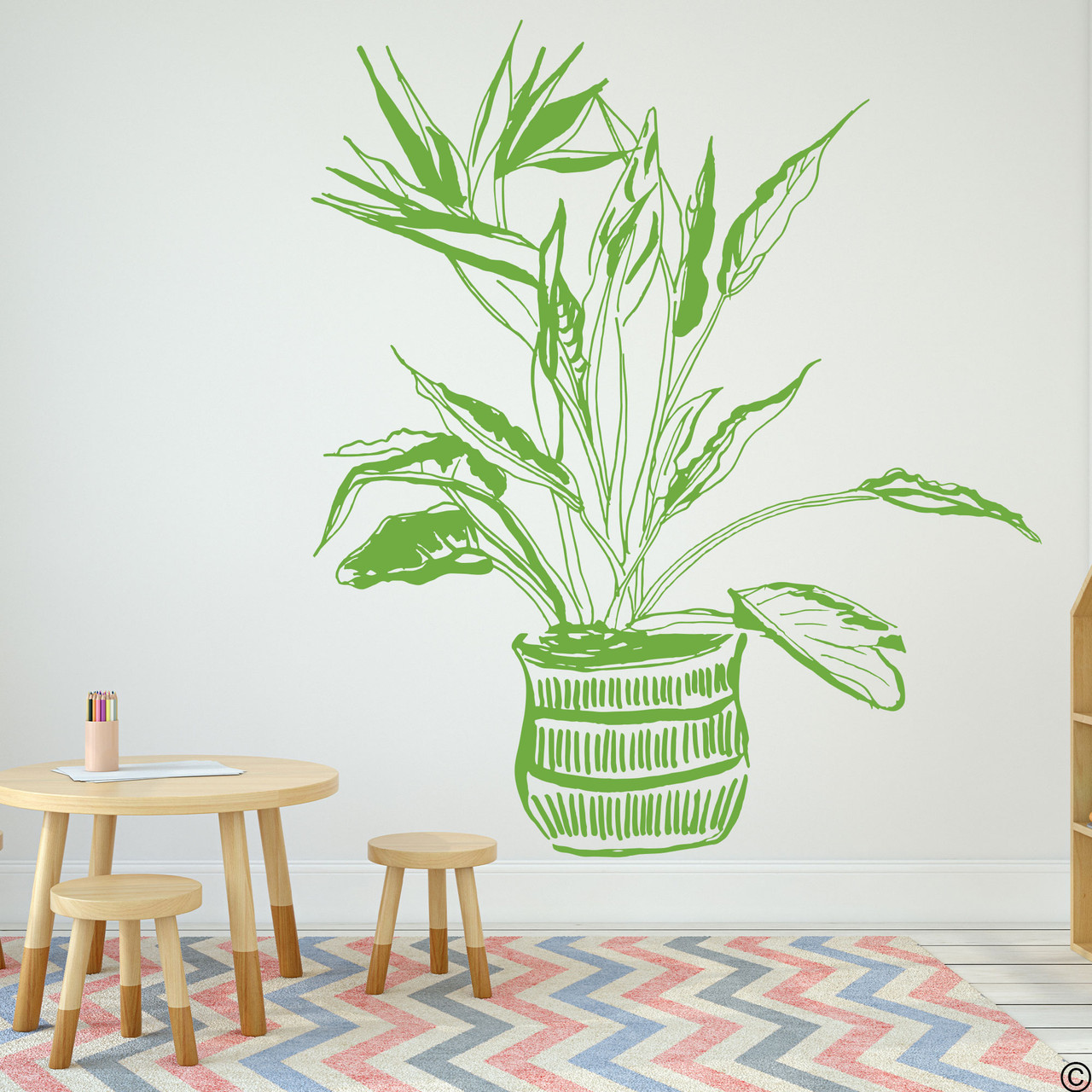 The hand drawn Bird of Paradise potted plant wall decal in the green vinyl color.