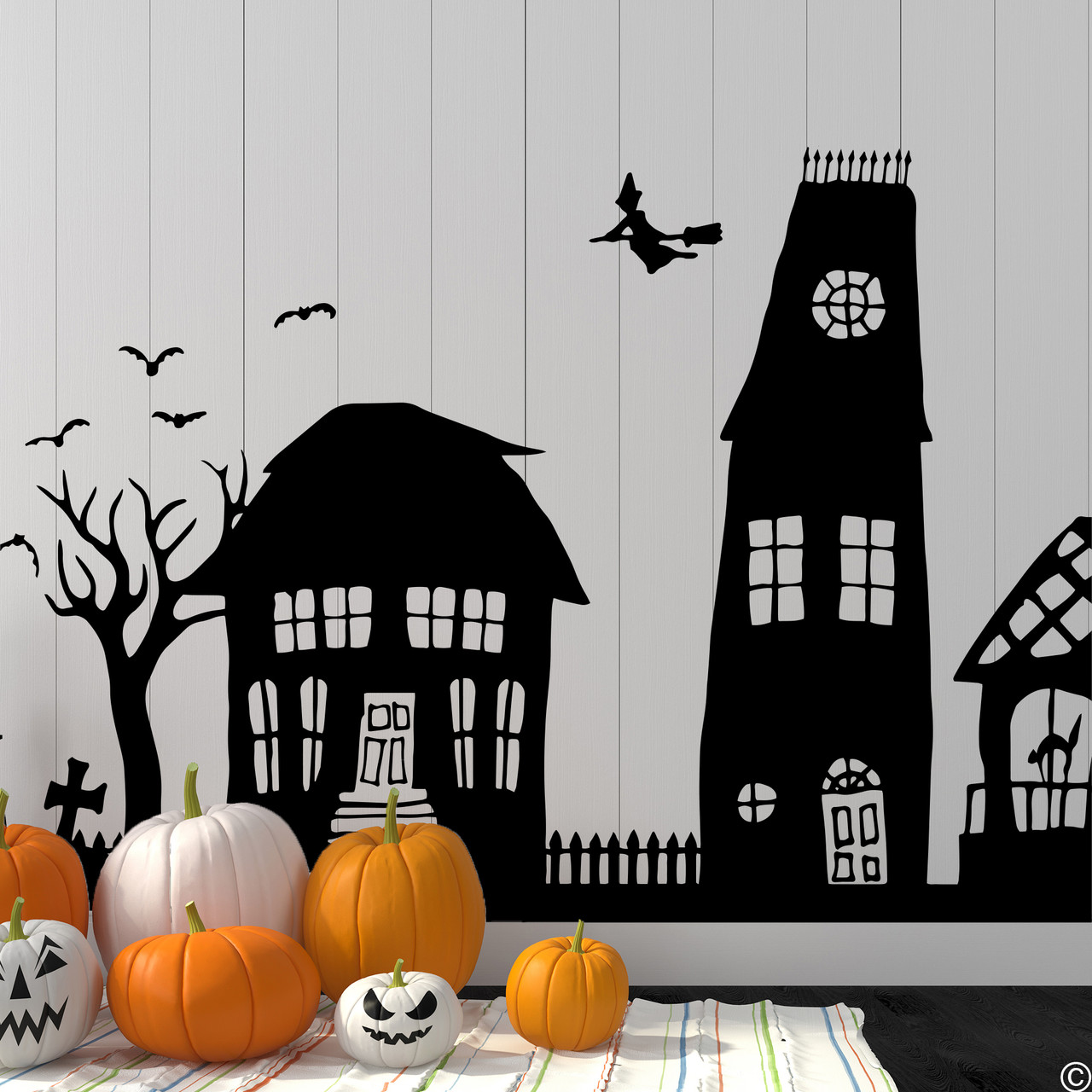 The Halloween houses wall decal in black vinyl color.