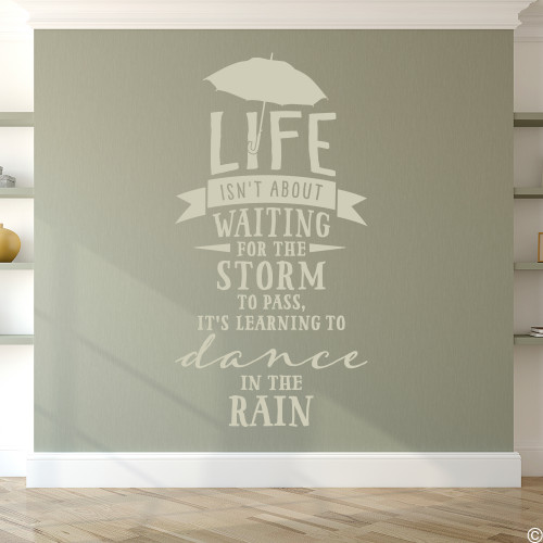 "Wall quote ""Life isn't about waiting for the storm to pass, it's learning to dance in the rain,"" vinyl wall decal in warm grey"