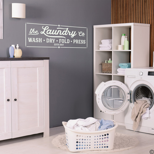 The Laundry Company wall decal quote in antique lace vinyl, on a laundry room wall with personalized establish date.